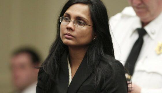 Annie Dookhan listens to the judge during her arraignment at Brockton Superior Court in Brockton, Massachusetts