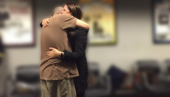 Wife hugging husband after being released from prison