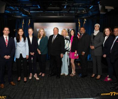 Vinoo with Manhattan DA Candidates, Moderator Dominic Carter, and 77 WABC Owner, John Catsimatidis